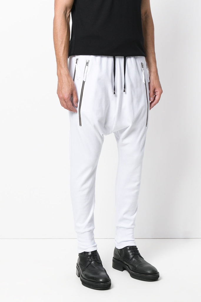 UNCONDITIONAL SS17 White drop crotch full length trousers with double long zip pocket.
