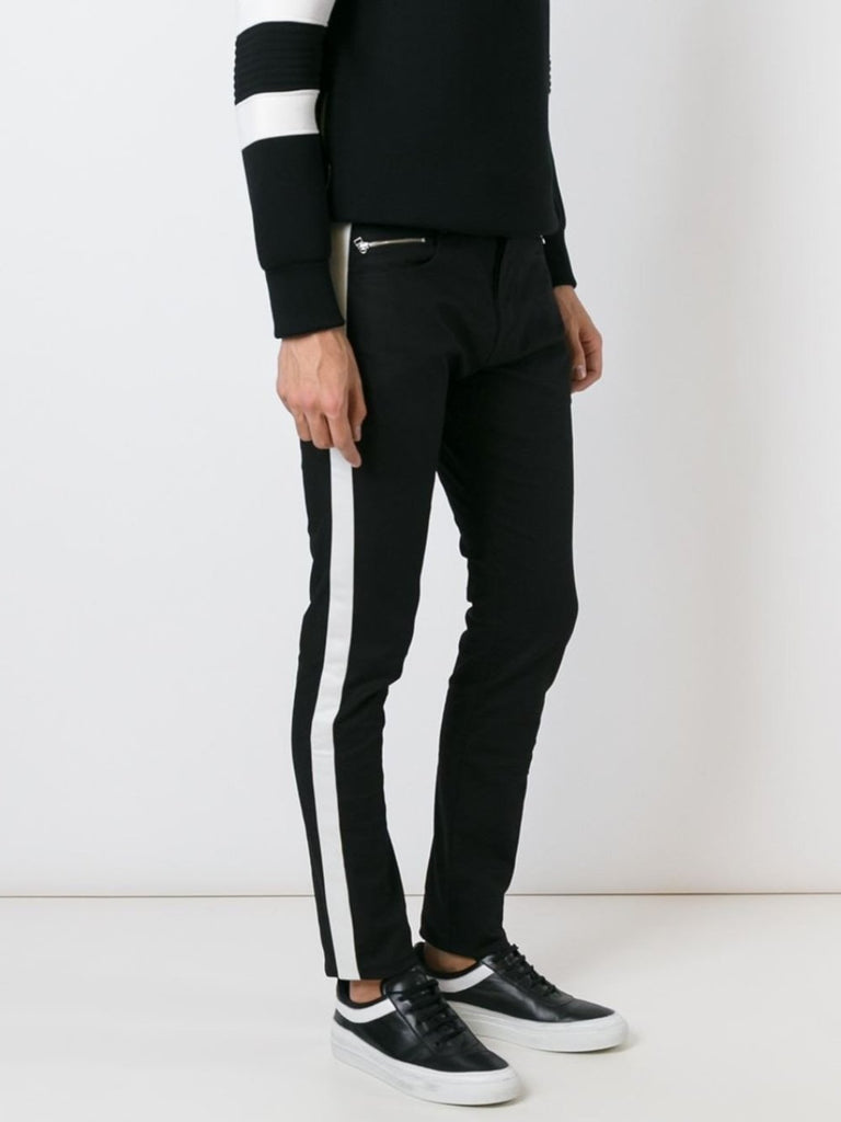 UNCONDITIONAL ankle length Black stretch denim tuxedo jeans with white tux stripe.