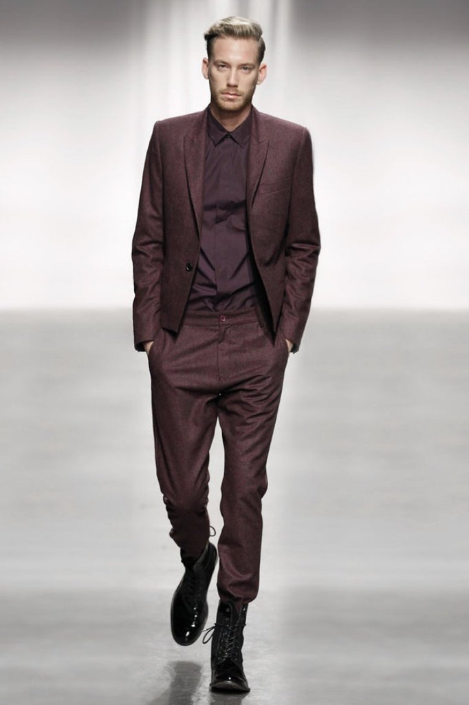 UNCONDITIONAL Burgundy wool flannel relaxed drop crotch trousers.