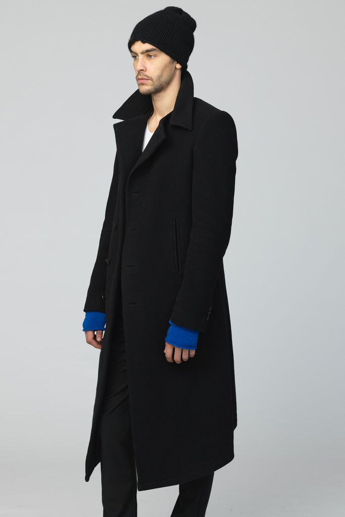 UNCONDITIONAL black wool  long asymmetric hem coat with zip off collar and zip back vent. cot401
