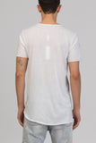 UNCONDITIONAL white round neck tee with raw hems and new fern print.
