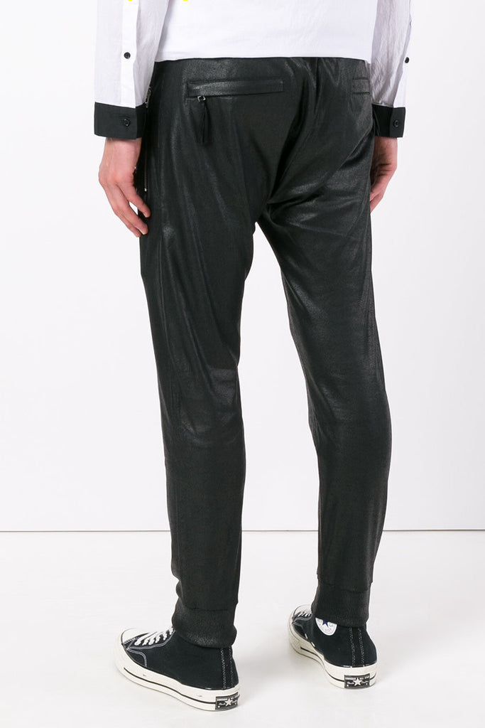 UNCONDITIONAL Black leather look matt foil jersey slim trousers - zip up pockets front and back.