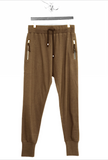 UNCONDITIONAL AW19 TAUPE SLIM jersey trousers with zip up pockets.