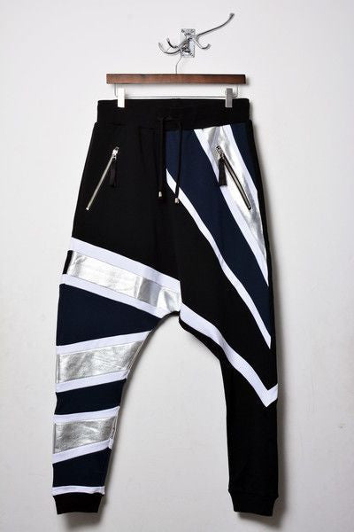 UNCONDITIONAL tribal stripe drop crotch trouser in black, petrol, white and silver stripes