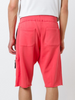 UNCONDITIONAL coral knee length luxe sweat shorts with lower zip pocket