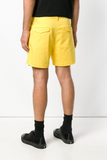 UNCONDITIONAL Yellow cotton drill tailored shorts.