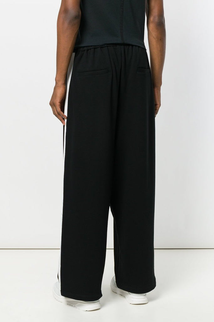 UNCONDITIONAL AW19 Black | Off White wide tuxedo stripe sweat trousers
