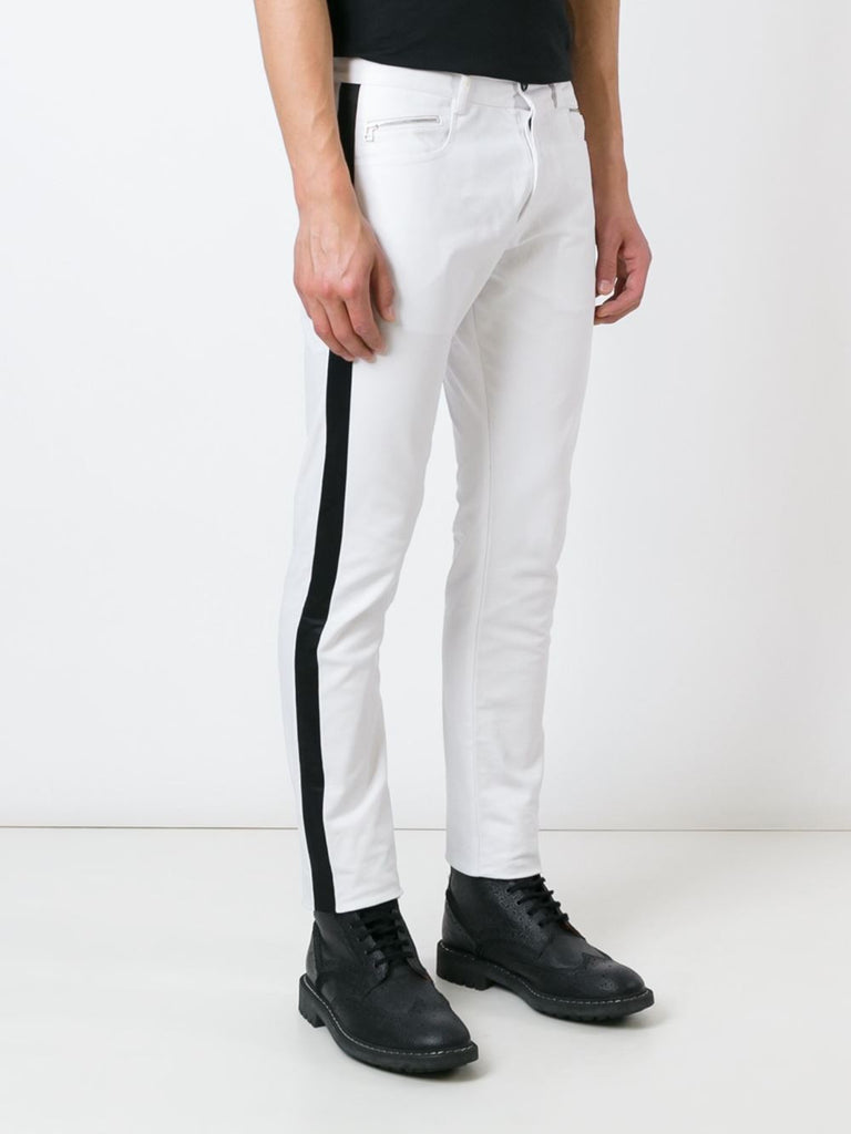 UNCONDITIONAL Ankle length white stretch denim tuxedo jeans with black silk tux stripe.