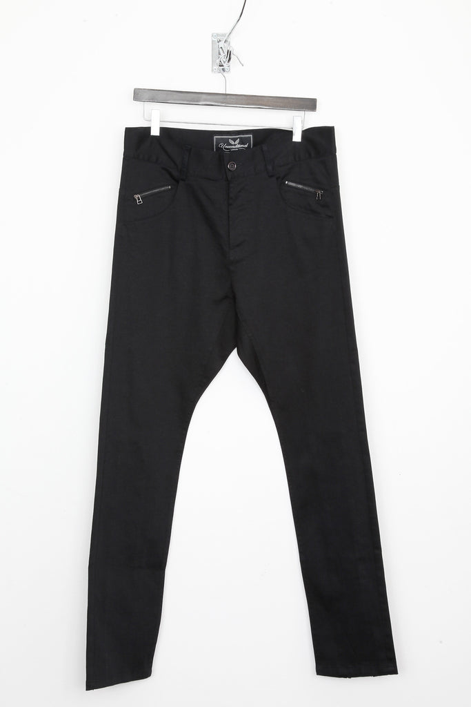 UNCONDITIONAL Dropped crotch jeans in black stretch denim with black back zips.