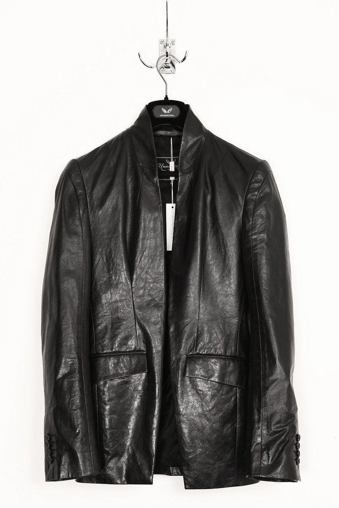 UNCONDITIONAL signature paper leather high collar cut away jacket.
