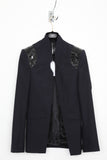UNCONDITIONAL navy high collar cutaway jacket with notch and patent leather shoulders.