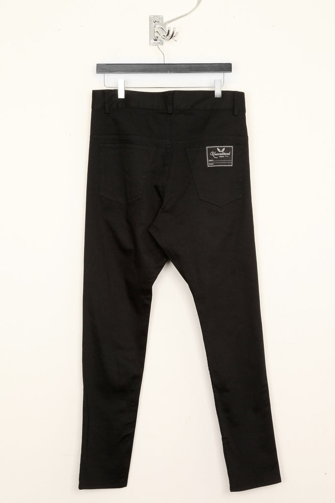 UNCONDITIONAL Black heavy stretch denim drop crotch jeans.