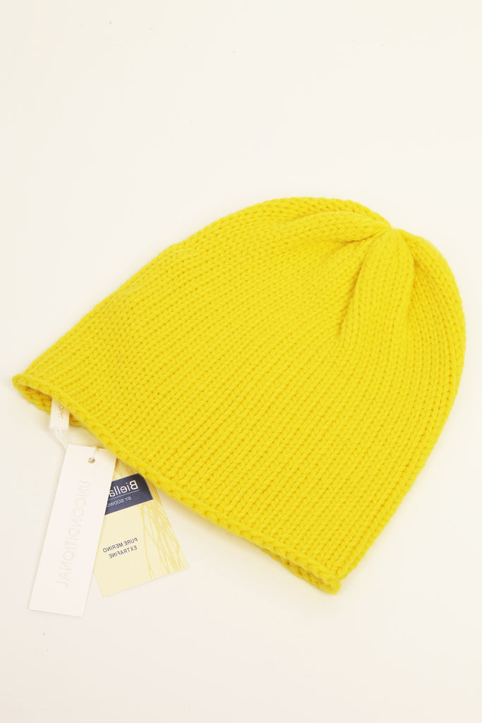 UNCONDITIONAL yellow merino signature hand knitted beanie.