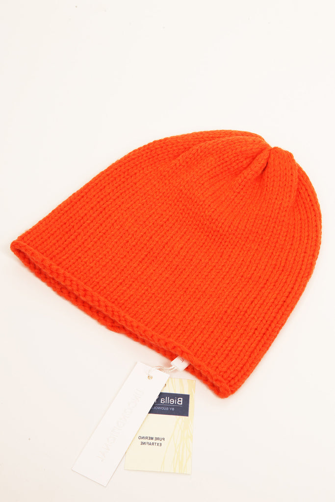 UNCONDITIONAL's signature Orange heavy merino handknitted beanie.