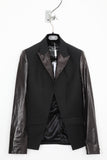 UNCONDITIONAL black cutaway jacket with leather lapel and sleeves.