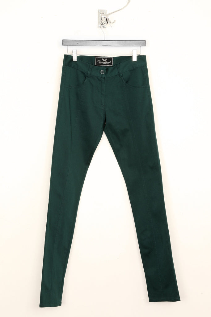 UNCONDITIONAL emerald green stretch denim skinny jeans.