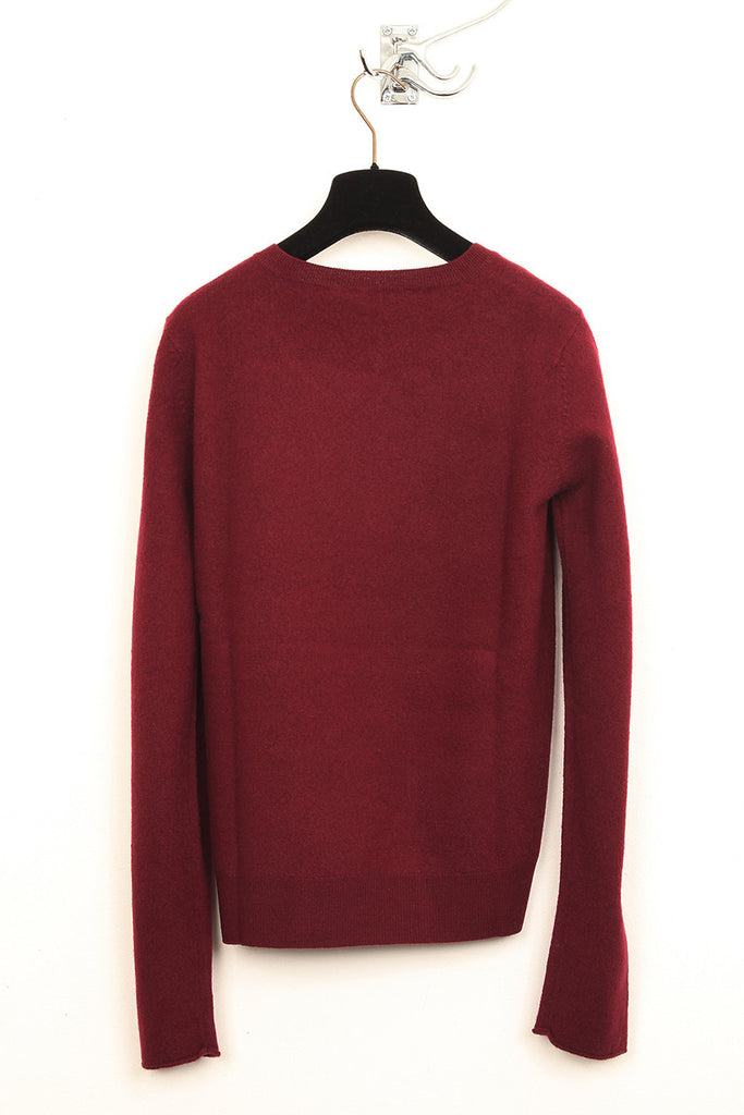 UNCONDITIONAL Burgundy boiled merino wool round neck jumper.