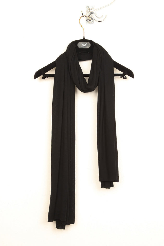 UNCONDITIONAL black rayon loose knit scarf.