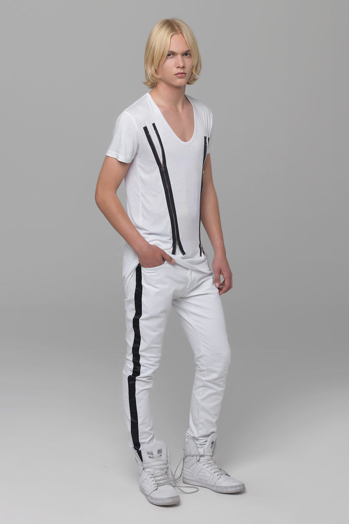 UNCONDITIONAL white light stretch denim skinny jeans with black silk tuxedo stripe.