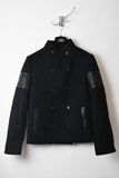 UNCONDITIONAL Pure wool funnel pea coat with leather arm rib detailing.