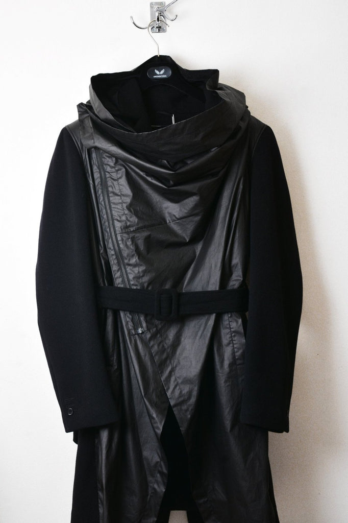 UNCONDITIONAL AW16 black double layered front drape hooded storm coat.