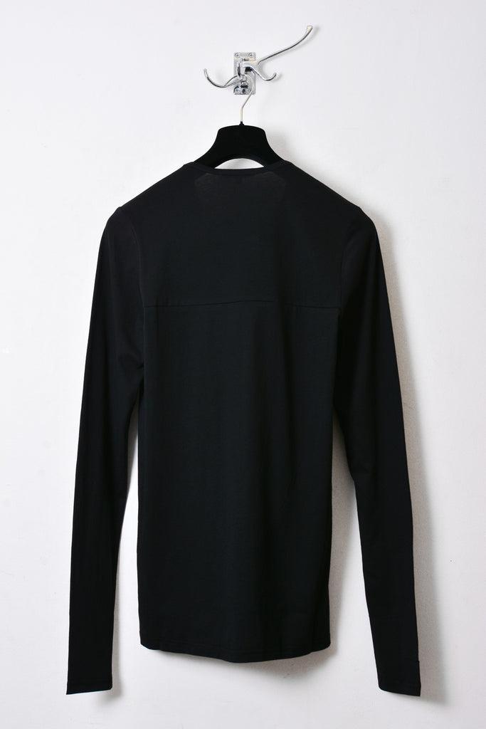 UNCONDITIONAL black and silver long sleeved tee with inserted chest fin.