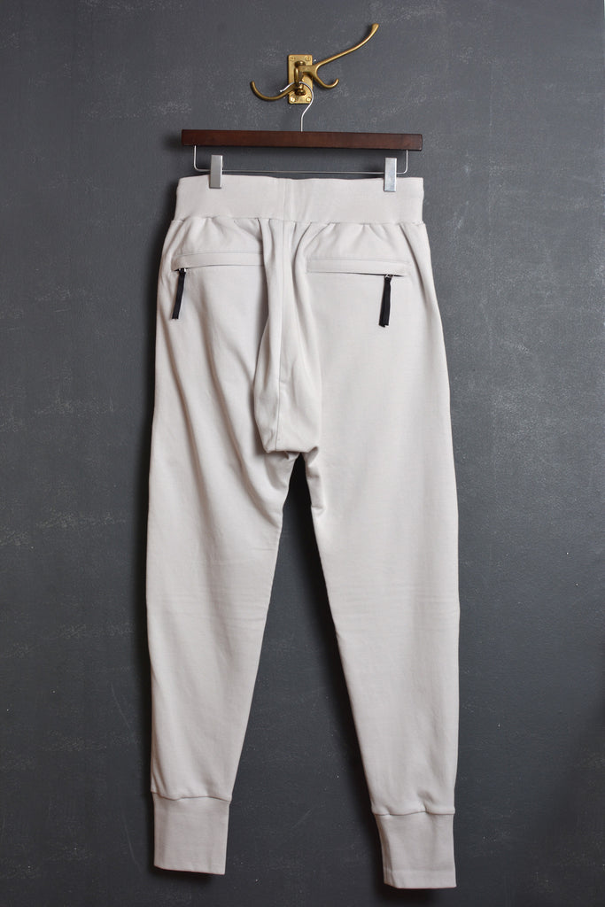 UNCONDITIONAL dirty white full length jersey trouser with new knee piping details.
