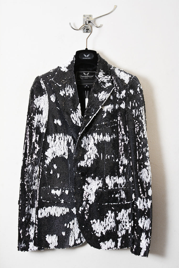 UNCONDITIONAL Black and white one button fully sequinned jacket with peak lapel.