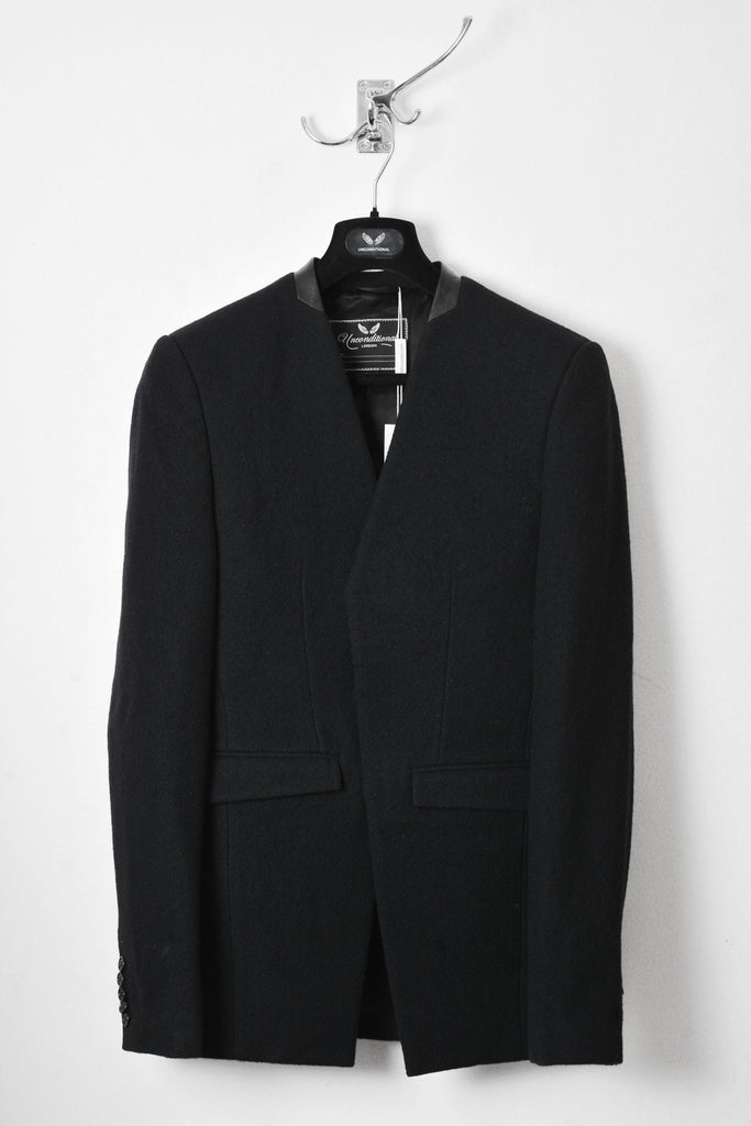 UNCONDITIONAL Black boiled wool cutaway tailored jacket with black leather collar..