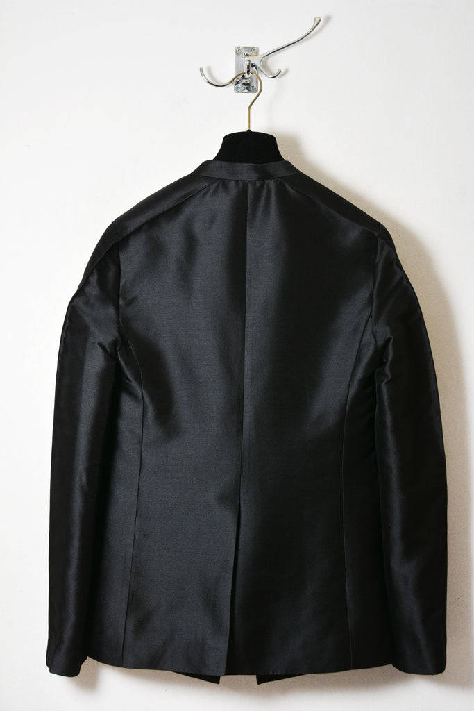 UNCONDITIONAL AW15 Black silk mix couture box shouldered jacket.