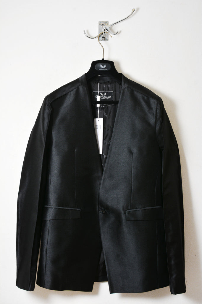 UNCONDITIONAL AW18 Black Box shouldered , angled cutaway jacket.