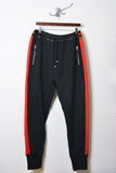 UNCONDITIONAL Black and red slim fit contrast tuxedo stripe sweat shirting trousers.