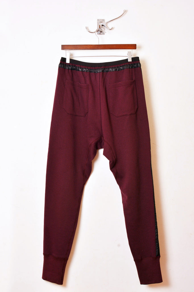 UNCONDITIONAL loganberry slim fit sweat shirting trousers with a microfibre tuxedo stripe.