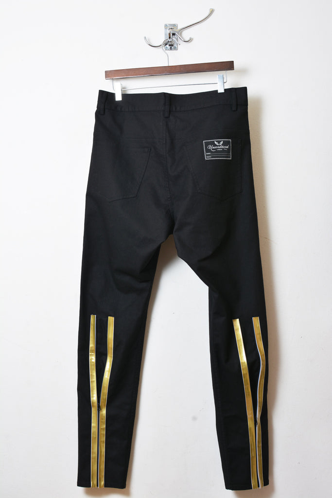 UNCONDITIONAL Black jeans with gold taped back zip and subtle dop crotch