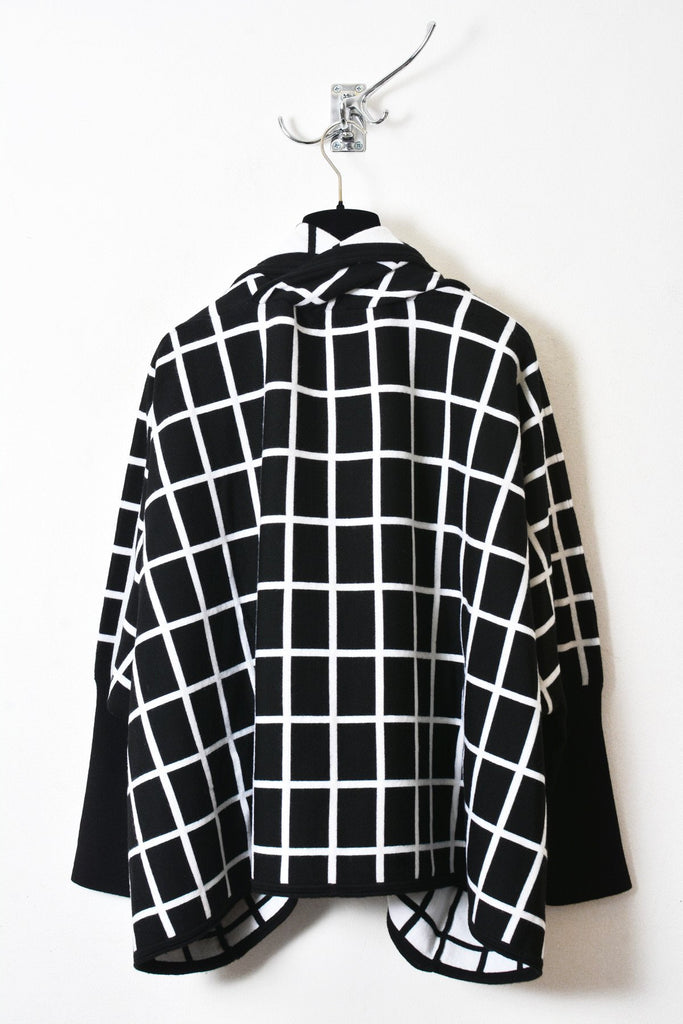 UNCONDITIONAL AW17 Black and white cocoon grid coat.