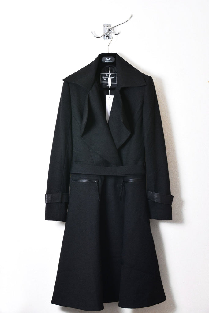 UNCONDITIONAL Black belted knee length romantic coat with leather trims.