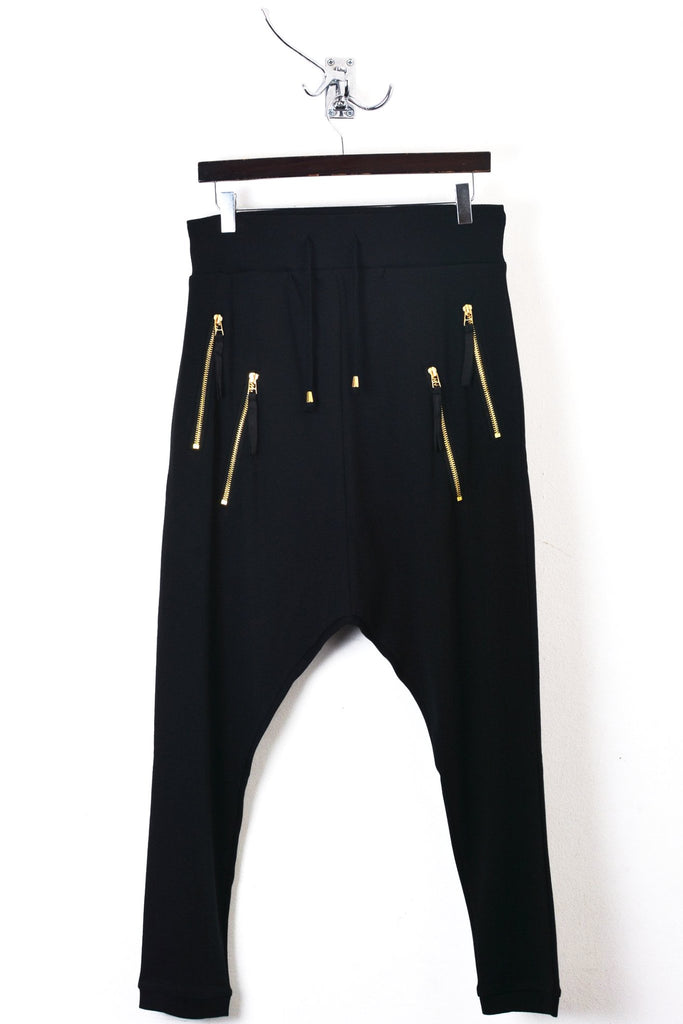 UNCONDITIONAL Ladies black drop crotch trousers with double gold-zip pockets