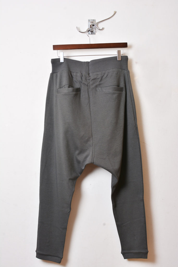 UNCONDITIONAL military drop crotch harem trousers with double zip pockets.
