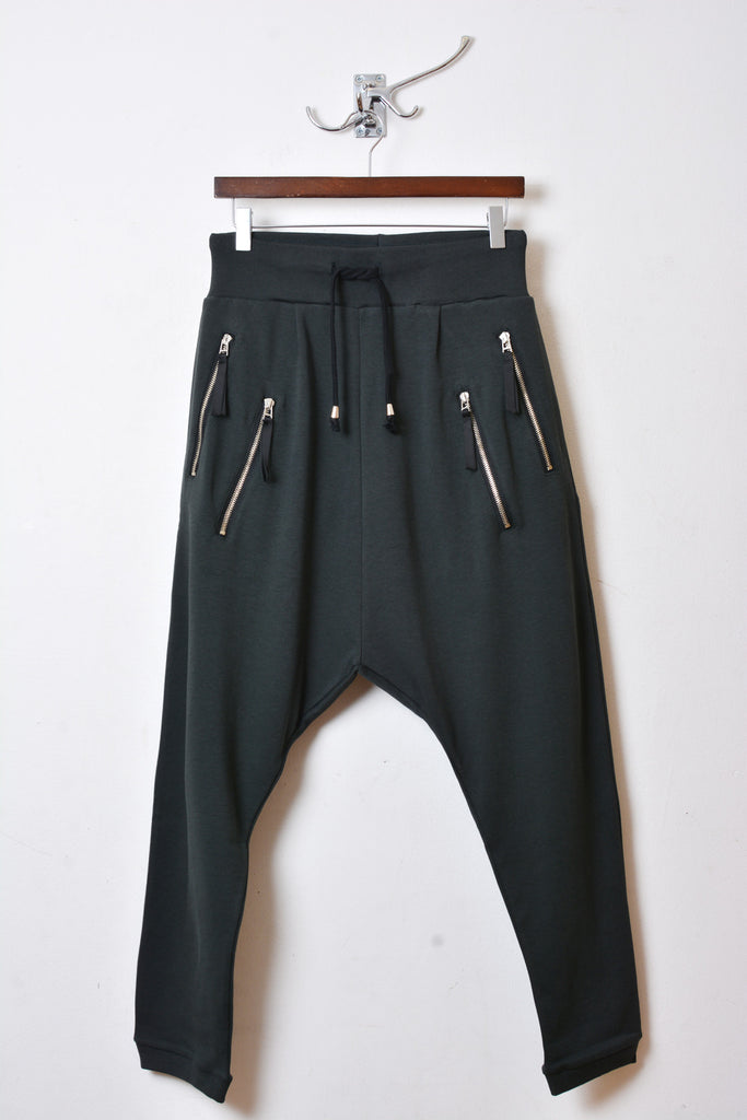 UNCONDITIONAL New tar drop crotch full length trousers with silver double zip pockets.