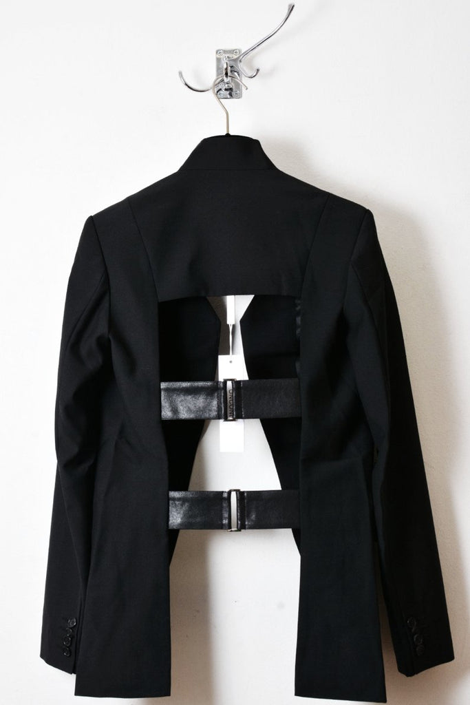 UNCONDITIONAL Black cutaway cage back jacket with silver ring and leather straps.