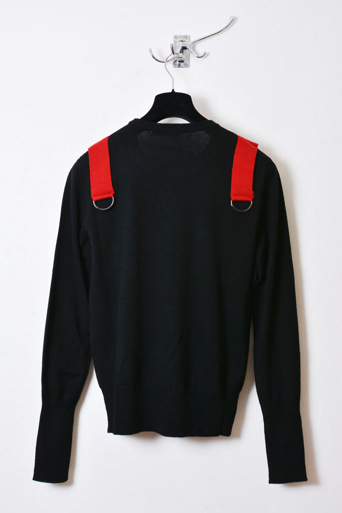UNCONDITIONAL AW15 black and red crew neck jumper with shoulders straps and silver ring.