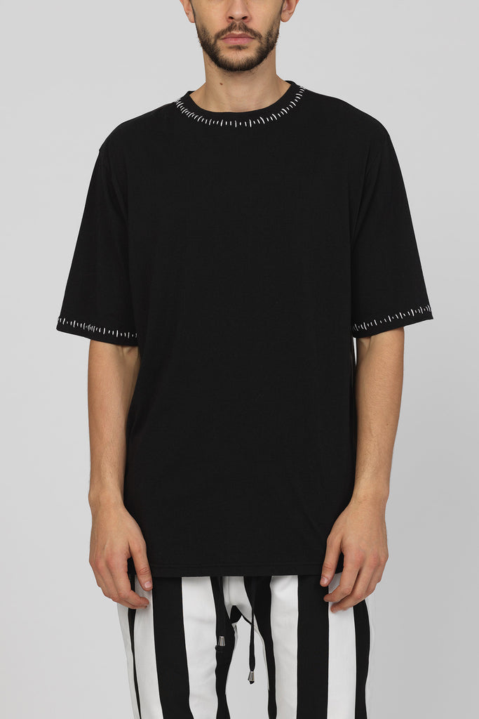 UNCONDITIONAL black and dark grey over sized t-shirt with contrast white stitching.