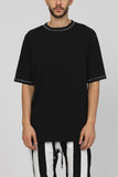 UNCONDITIONAL Black oversized T with contrast white hand stitching to neck and cuffs.