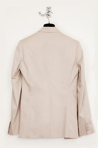 UNCONDITIONAL Nude light cotton silk lined cutaway jacket.