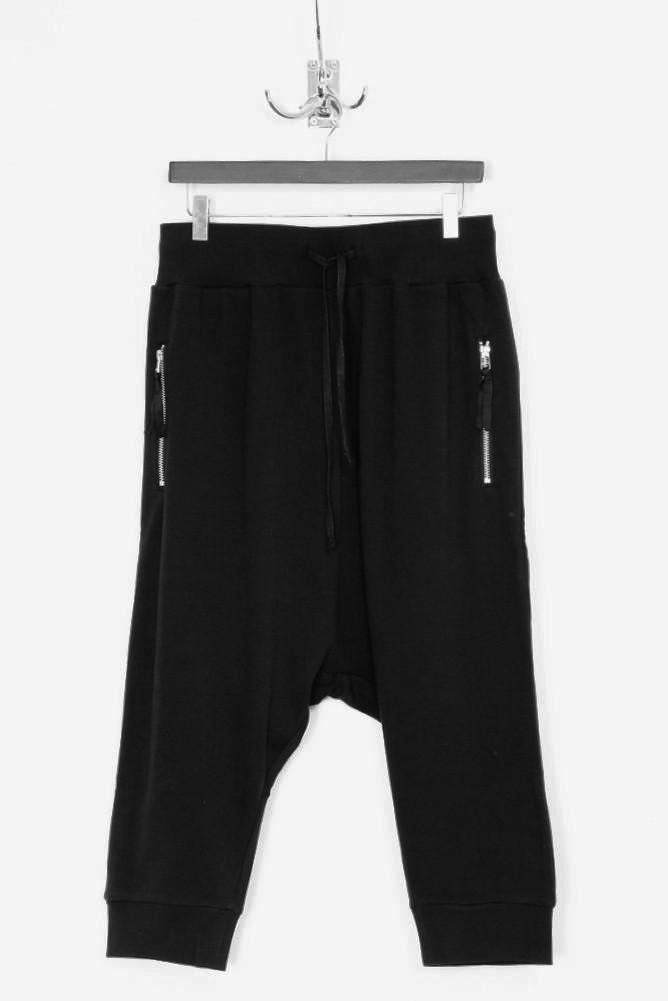 UNCONDITIONAL Black drop crotch shorts with rib waistband.