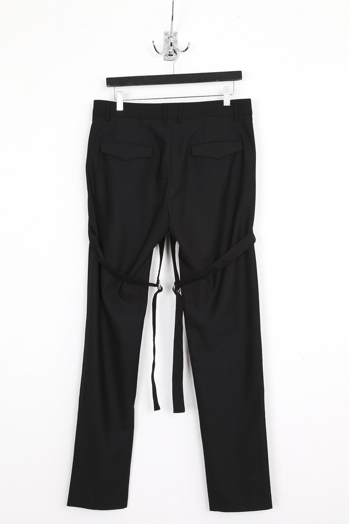 UNCONDITIONAL Signature Black tailored wool slim fit trousers with back D-Ring bondage straps.