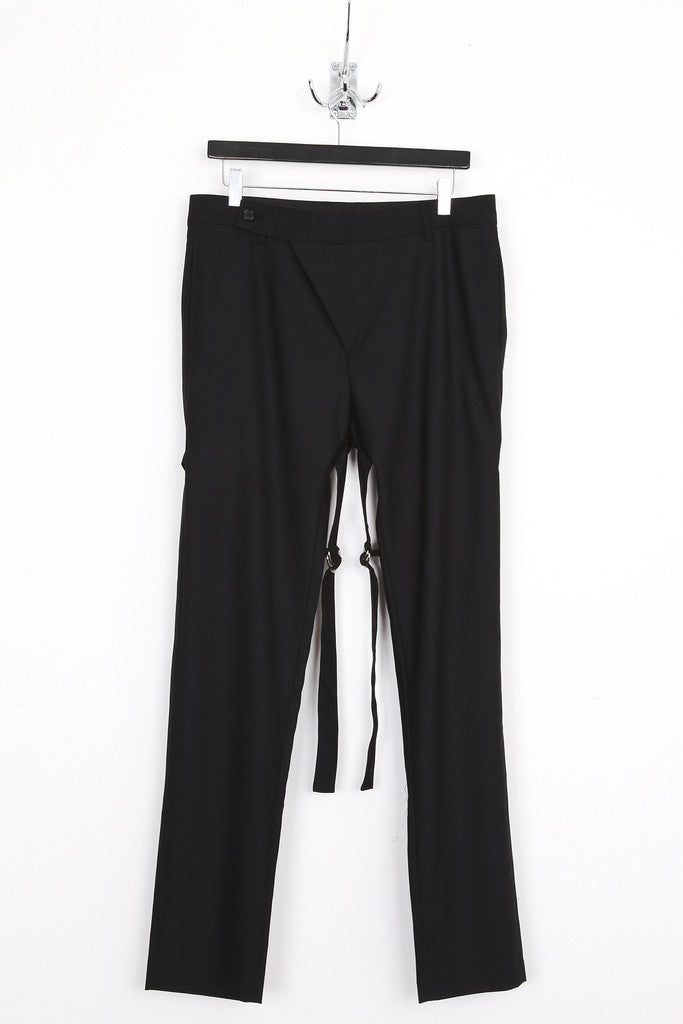 UNCONDITIONAL black tailored wool slim fit trousers with back D-Ring bondage straps.