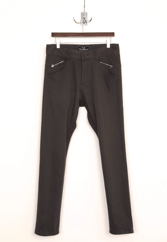 UNCONDITIONAL dark grey stretch drill drop crotch jeans with back zips .