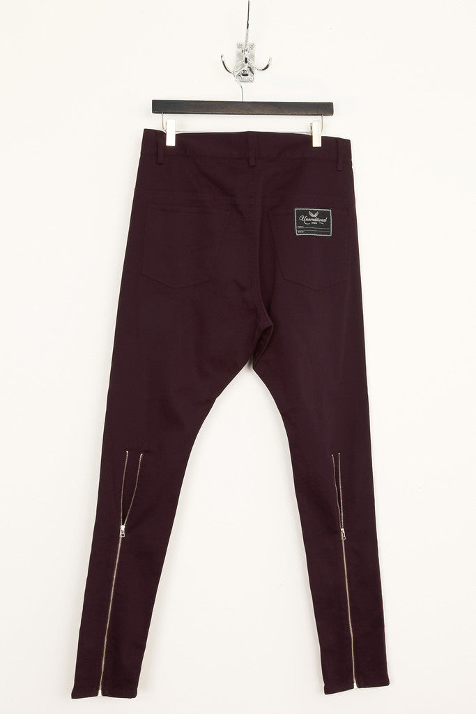 UNCONDITIONAL dark purple drop crotch back zip jeans.