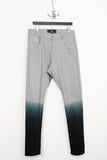 UNCONDITIONAL light grey dip dye drop crotch back zip jeans.